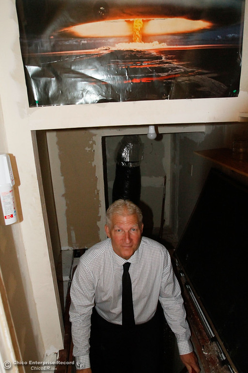 . Arthur Wellersdick exits the 1960s era bomb shelter under his house along Stewart Avenue Thursday July 27, 2017 in Chico, California. (Emily Bertolino -- Enterprise-Record)