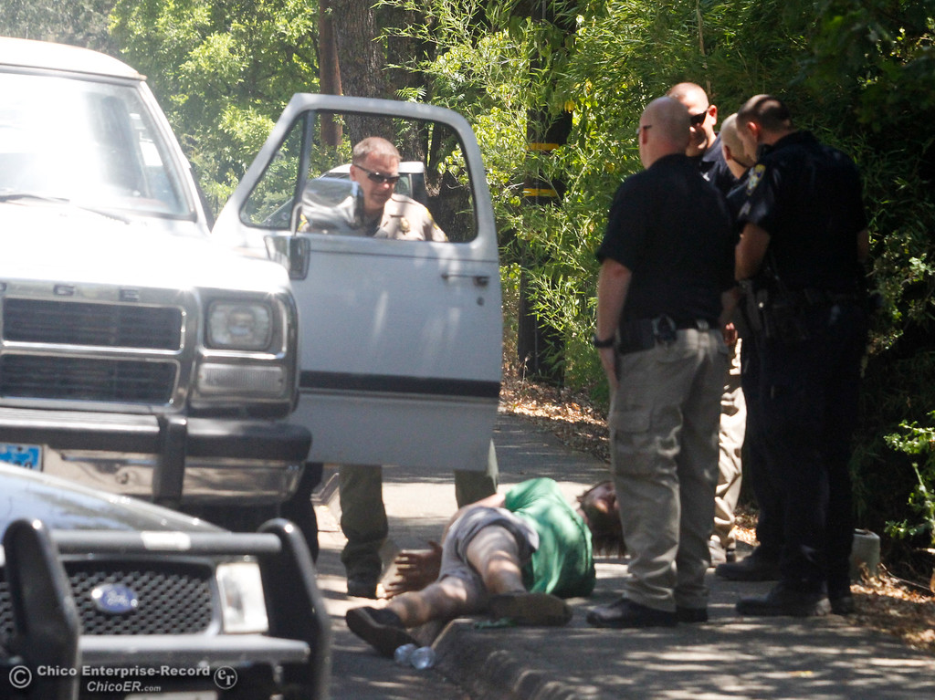 . A man is arrested for driving through a road block that was set up along Buschmann Road as firefighters work to contain a vegetation fire July 25, 2017 in Paradise, California. (Emily Bertolino -- Enterprise-Record)