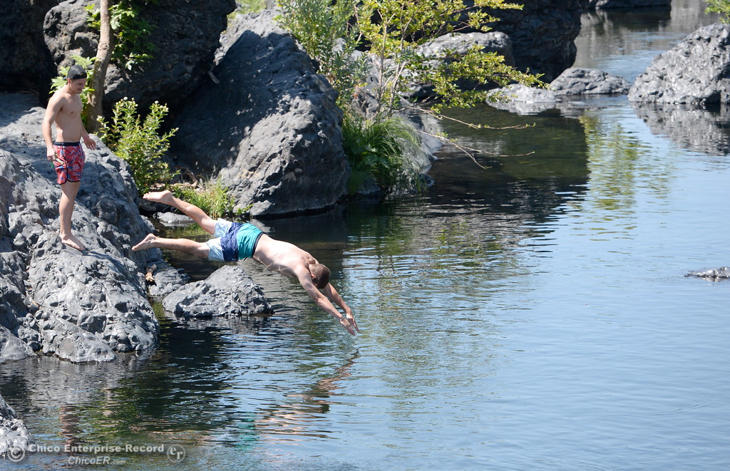 . Alex Martin, left and Richard Prentice of Chico enjoy a swim at Bear Hole in Upper Bidwell Park, Chico Calif. Tuesday July 25, 2017.  (Bill Husa -- Enterprise-Record)