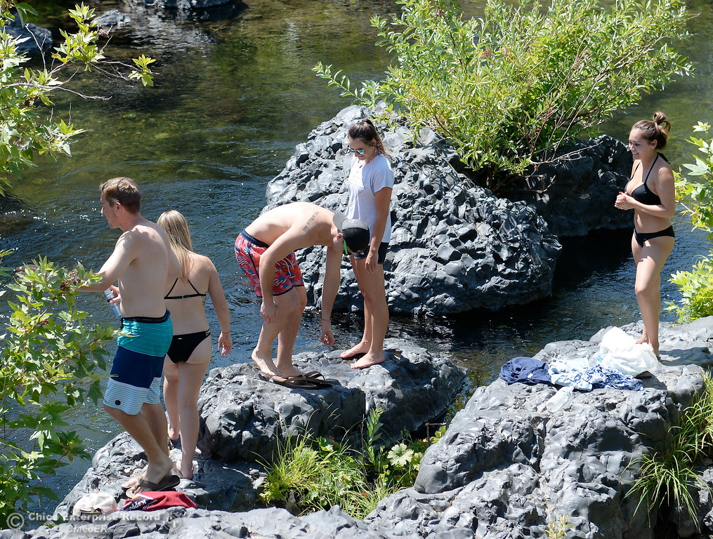 . A group of Chico locals find the rocks hot on bare feet as they get ready to enjoy a swim near Bear Hole in Upper Bidwell Park, Chico Calif. Tuesday July 25, 2017.  (Bill Husa -- Enterprise-Record)