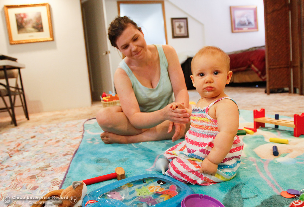. Jennifer Davis plays with baby Pearl as she talks about her experience losing her home during Wall Fire Wednesday July 26, 2017 in Chico, California. (Emily Bertolino -- Enterprise-Record)
