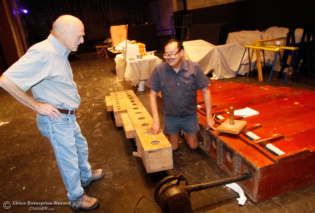 . Dave Moreno (right) organ expert talks with David Miller (left) about organ acoustics as volunteers work on the reinstallation of the Mighty Wurlitzer Theater Organ Saturday July 29, 2017 at the State Theatre in Oroville, California. (Emily Bertolino -- Enterprise- Record)