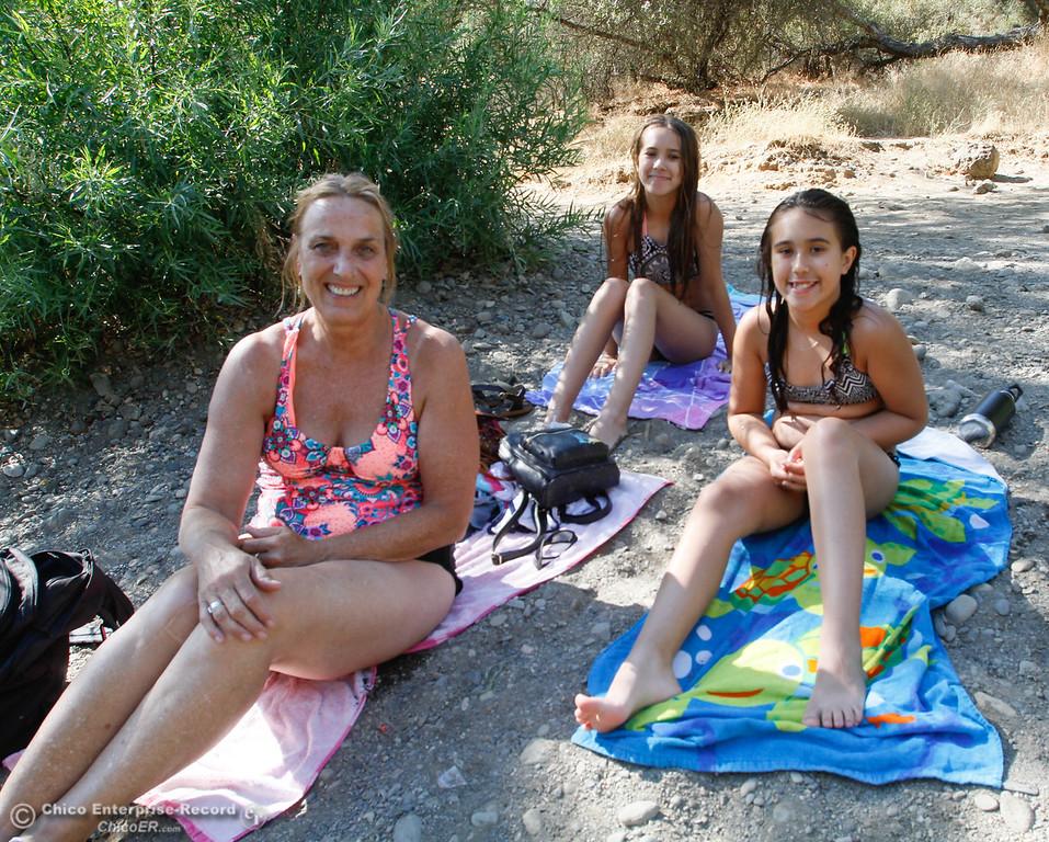 . Lynn Larson (left) takes her grandchildren Sofia (center) and Gianna Lamb  swimming along Butte Creek under the Honey Run Covered Bridge Tuesday July 25, 2017 in Chico, California. (Emily Bertolino -- Enterprise-Record)