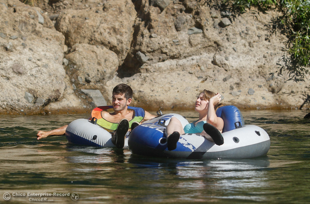 . A couple floats down Butte Creek under the Honey Run Covered Bridge Tuesday July 25, 2017 in Chico, California. (Emily Bertolino -- Enterprise-Record)