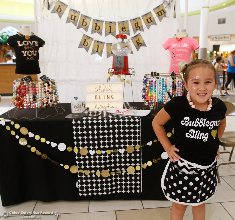 """. Audrey Vu, stands in front of her shop, \""""Bubblegum Bling,\"""" during the Biz Kids showcase Saturday July 29, 2017 at the Chico Mall in Chico, California. (Emily Bertolino -- Enterprise- Record)"""
