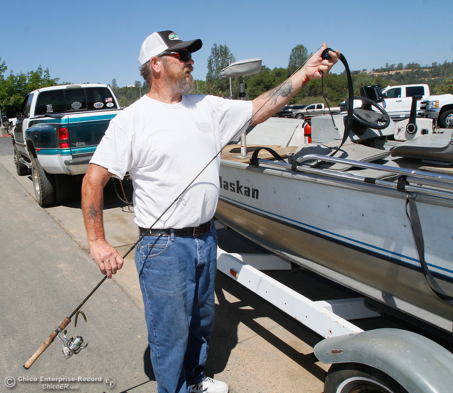 . Larry Petersen of Magalia packs up his fishing gear as he agrees more parking is needed Saturday July 29, 2017 in Paradise, California. (Emily Bertolino -- Enterprise- Record)