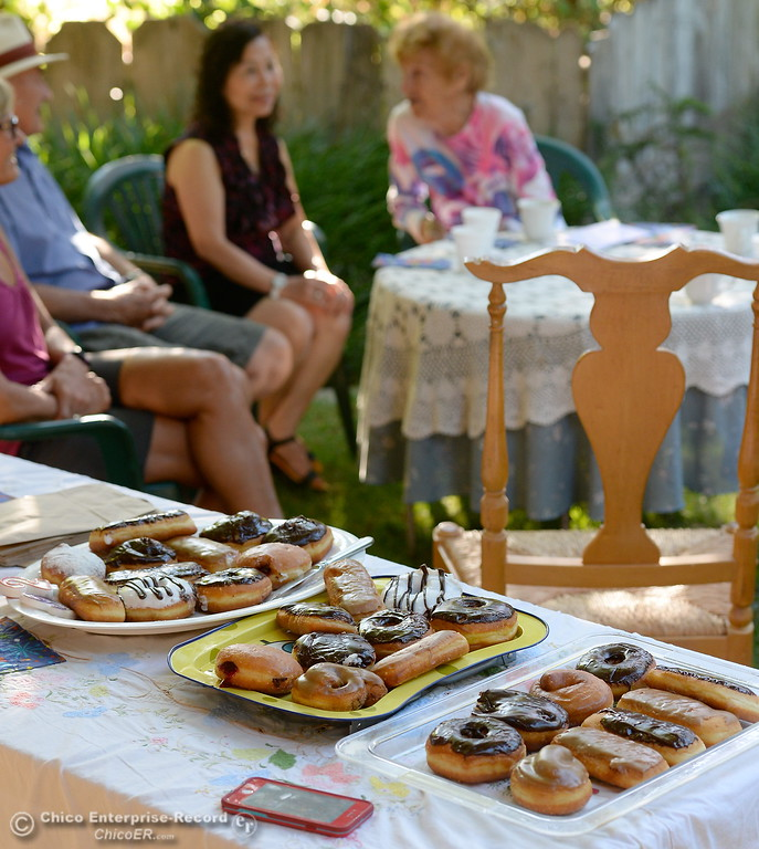 . Dorothy Sweeney, AKA Mayor of Bidwell Avenue hands out donuts to friends and neighbors as she celebrates her 92nd birthday Friday July 28, 2017. (Bill Husa -- Enterprise-Record)