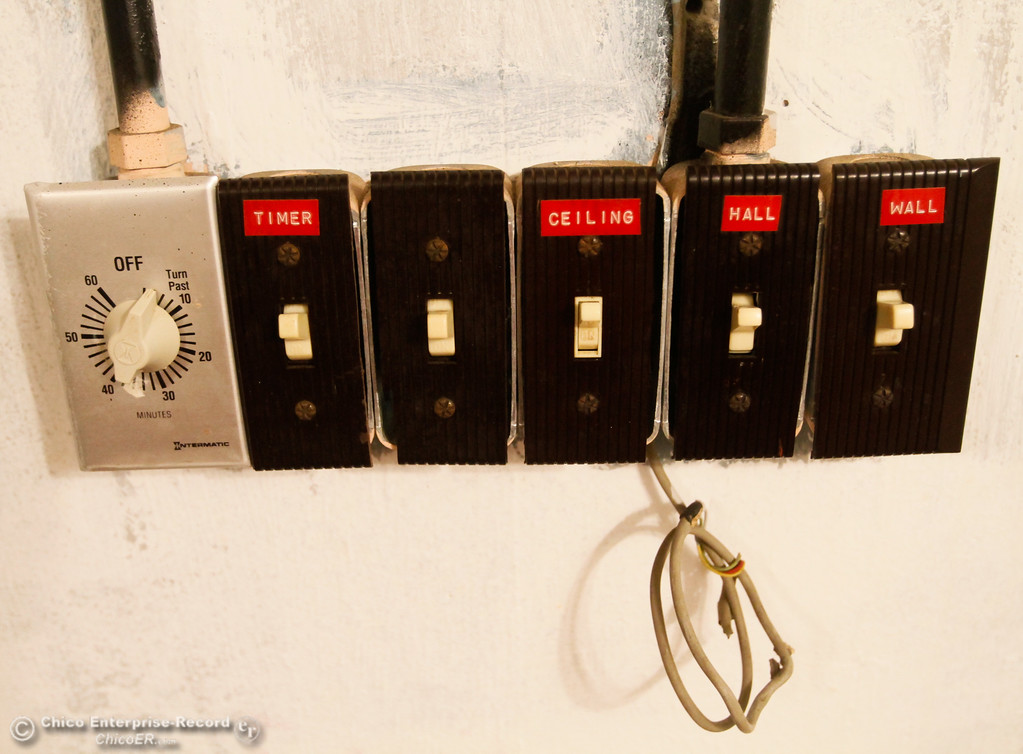 . Light switches on the wall of an 1960s era bomb shelter that sits nestled under a home along Steward Avenue Thursday July 27, 2017 in Chico, California. (Emily Bertolino -- Enterprise-Record)