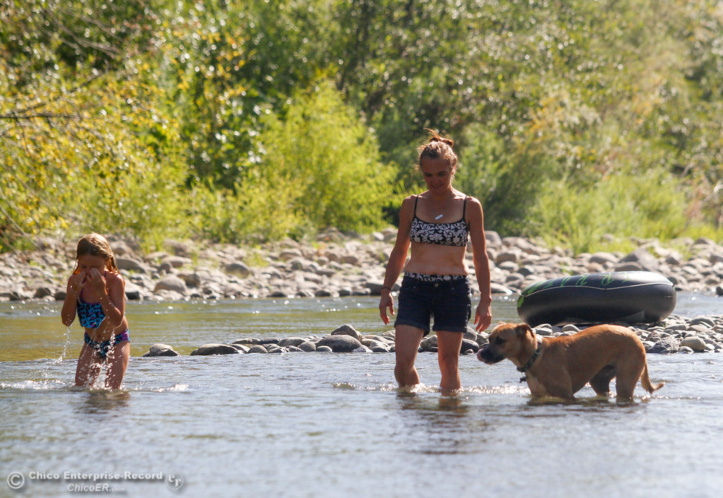 . Ingrid Patterson (center), Sadie Patterson (left) and Macy spent the afternoon swimming in Butte Creek under the Honey Run Covered Bridge Tuesday July 25, 2017 in Chico, California. (Emily Bertolino -- Enterprise-Record)