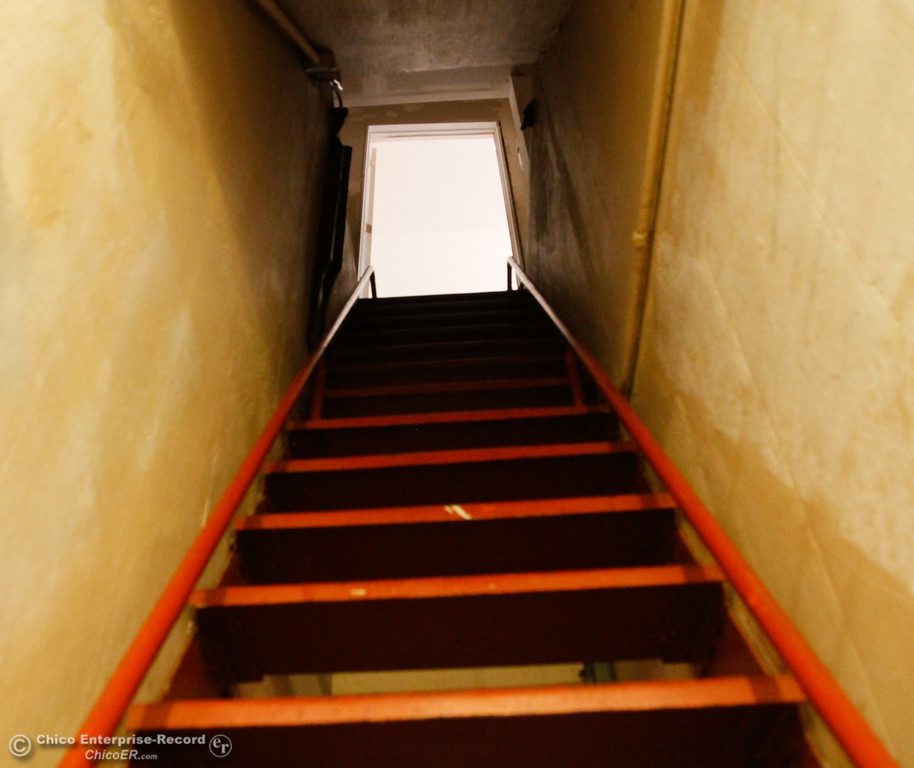 . A steep stairwell leads down to a 1960s era bomb shelter in a home along Stewart Avenue Thursday July 27, 2017 in Chico, California. (Emily Bertolino -- Enterprise-Record)