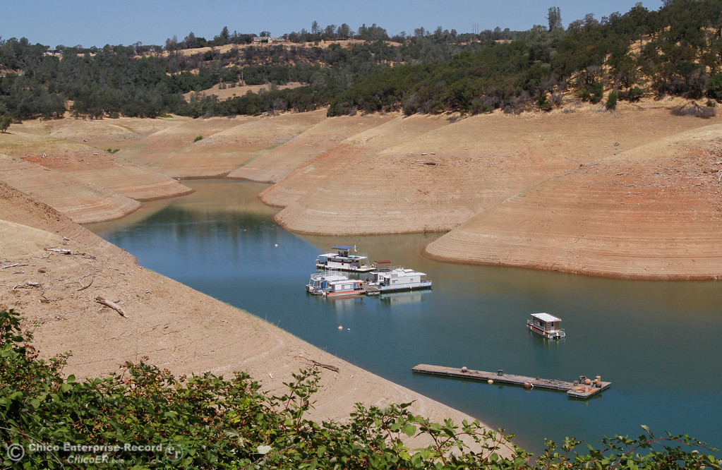 . It\'s been a while since houseboats have still been afloat in this section of Lake Oroville near Lime Saddle Marina Saturday July 29, 2017 in Paradise, California. (Emily Bertolino -- Enterprise- Record)