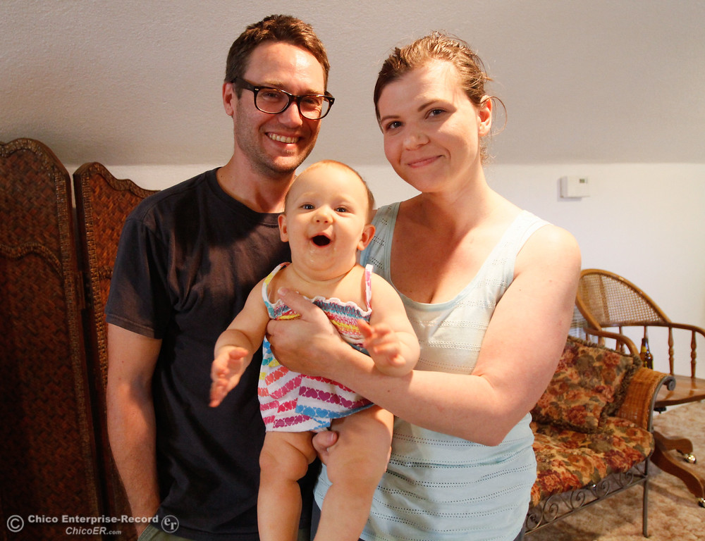 . Cody Richardson, Jennifer Davis and baby Pearl\'s pose for a picture as they talk about the experience of losing their home during the Wall Fire Wednesday July 26, 2017 in Chico, California. (Emily Bertolino -- Enterprise-Record)