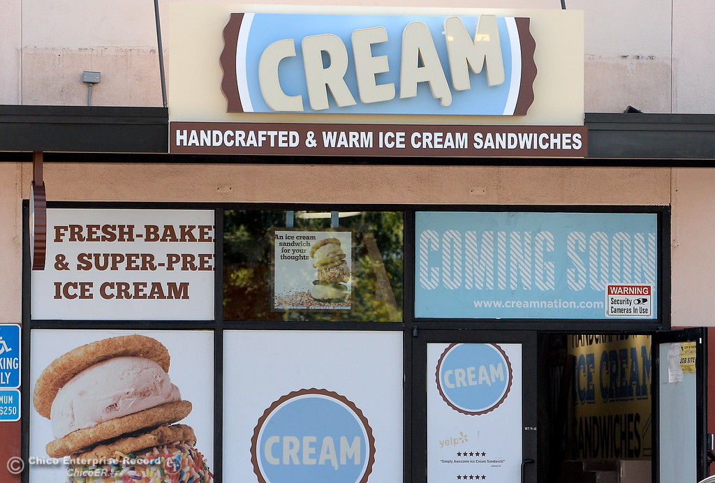 """. Cream is under construction in the North Valley Plaza next door to the Pour House Thursday July 27, 2017. A sign on the door says \""""We\'re Hiring.\"""" (Bill Husa -- Enterprise-Record)"""