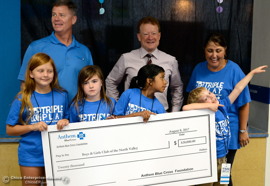 . Boys & Girls Club members hold a giant check before they get a chance to try out some of the new equipment and games after they received a $20,000 grant from Anthem Blue Cross for items at the Boys & Girls Club in Chico, Calif. Tues. Aug. 8, 2017. (Bill Husa -- Enterprise-Record)