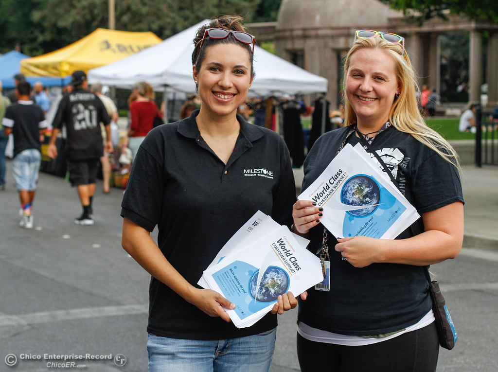 . Roxanne Reyes and Randi Ricks with Milestone Technologies pass out fliers to people who may be looking for a job August 10, 2017 at the Thursday Night Farmers Market  in Chico, California. (Emily Bertolino -- Enterprise- Record)