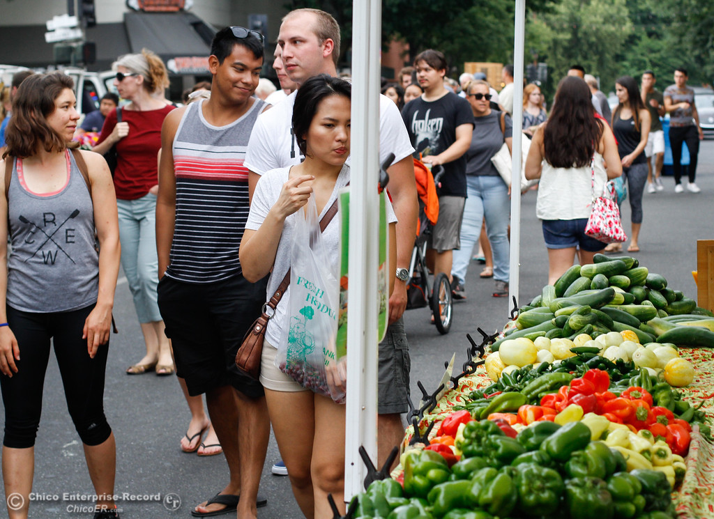 . People browse an array of fresh produce at the Thursday Night Farmers Market August 10, 2017  in Chico, California. (Emily Bertolino -- Enterprise- Record)