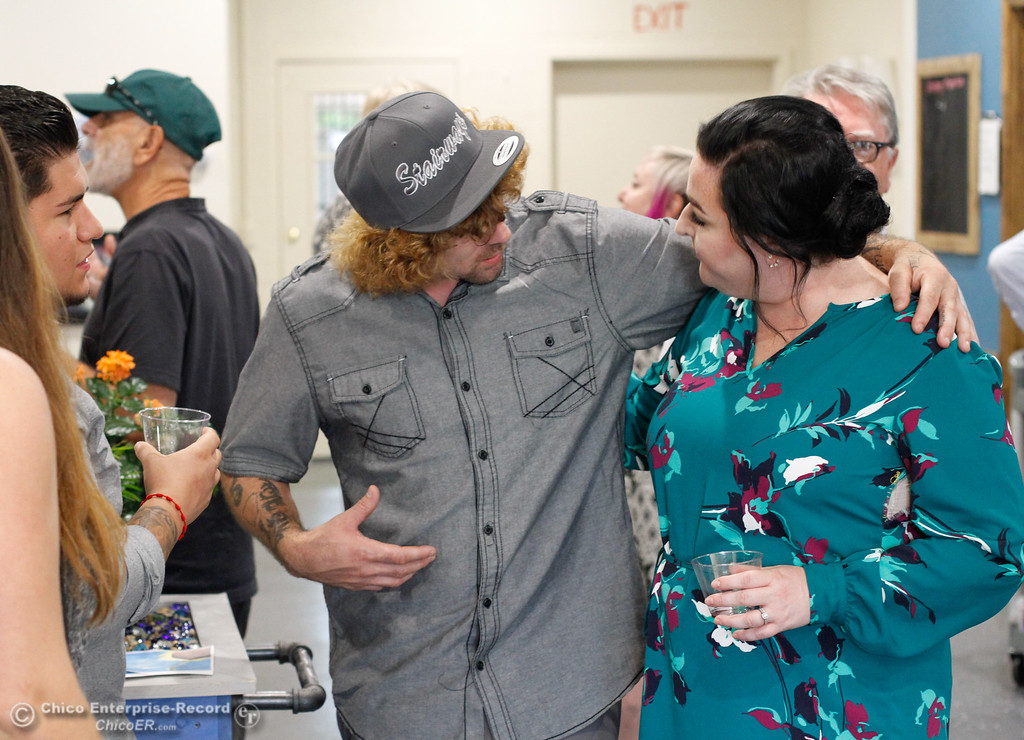 . People mingle during Stairways Harm Reduction Center\'s open house August 10, 2017  in Chico, California. (Emily Bertolino -- Enterprise- Record)