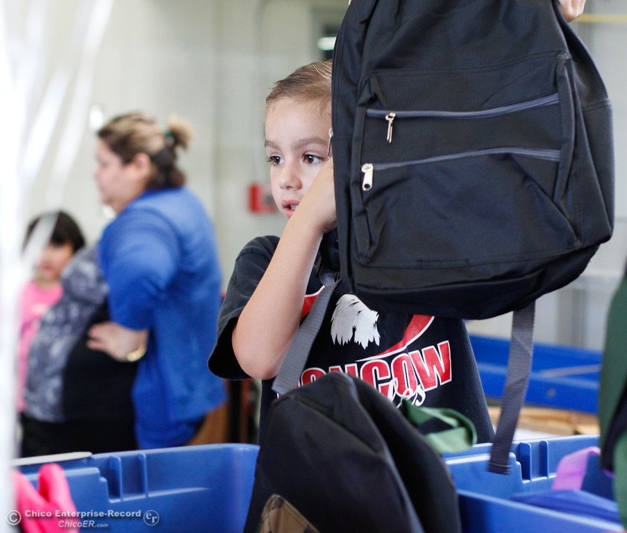 . Kain Nolan (6) picks out a new backpack during the Back to School Connect even organized by School Ties at the Butte County Office of Education Tuesday August 8, 2017 at Chico Junior High School in Chico, California. (Emily Bertolino -- Enterprise- Record)
