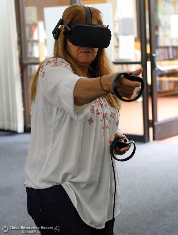 . Alexandra Lejune plays Oculus First Contact as a way to get acquainted with virtual reality while library patrons take part in an Oculus virtual reality experience August 8, 2017 at Butte County Library Chico Branch in Chico, California. (Emily Bertolino -- Enterprise- Record)