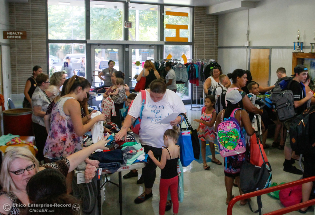 . Students and their parents pick out new clothes during the Back to School Connect even organized by School Ties at the Butte County Office of Education Tuesday August 8, 2017 at Chico Junior High School in Chico, California. (Emily Bertolino -- Enterprise- Record)