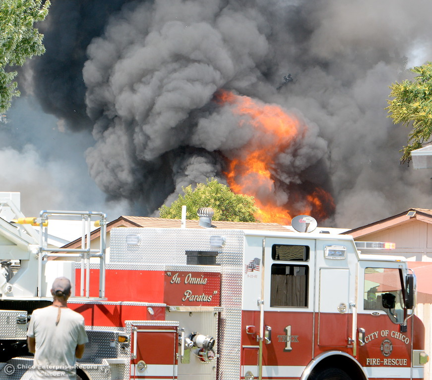 . Flames rise up from the burning structure as Truck 1 arrives to help battle a fire in a mobile home on Aster Drive at Casa De Flores  Mobile Home Park Tuesday Aug. 8, 2017. Ammunition stored in the residence hindered fire suppression and added difficulty in fighting the fire. (Bill Husa -- Enterprise-Record)