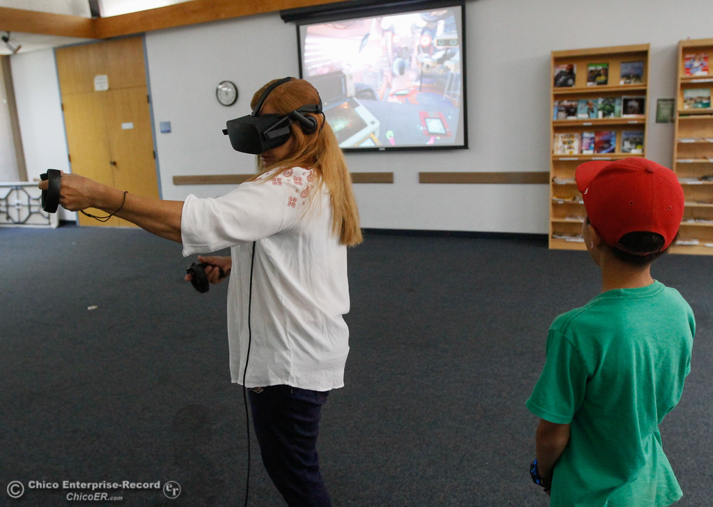 . Alexandra Lejune plays Oculus First Contact as a way to get acquainted with virtual reality as library patrons take part in an Oculus virtual reality experience August 8, 2017 at Butte County Library Chico Branch in Chico, California. (Emily Bertolino -- Enterprise- Record)