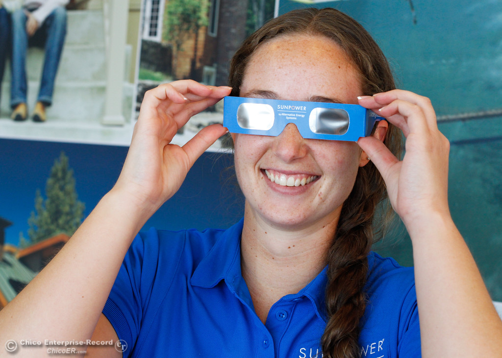 . Abby Skillicorn puts on a pair of safety solar glasses which people can use to watch the eclipse and SunPower by Alternative Energy Systems are giving away for free Saturday August 12, 2017 in Chico, California. (Emily Bertolino -- Enterprise- Record)
