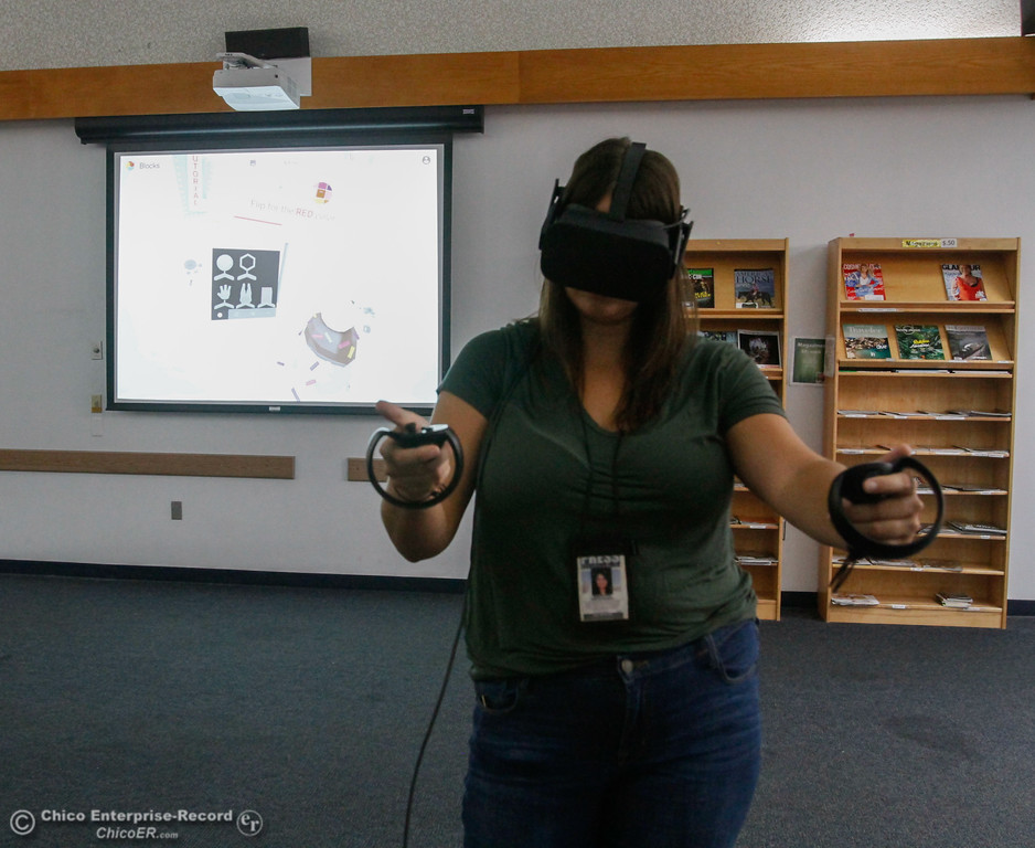 . Library patrons take part in an Oculus virtual reality experience August 8, 2017 at Butte County Library Chico Branch in Chico, California. (Emily Bertolino -- Enterprise- Record)