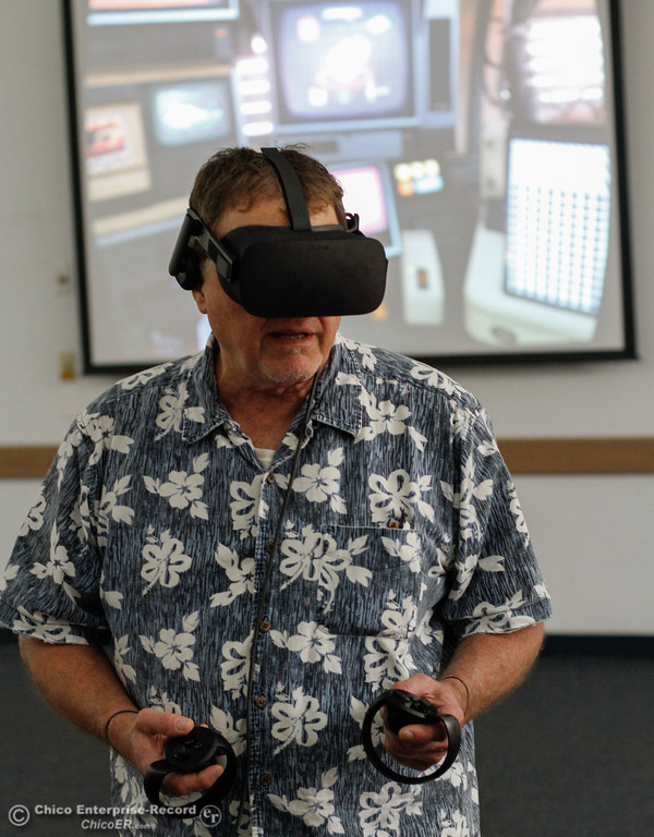 . James Chiarottino plays Oculus First Contact as a way to get acquainted with virtual reality while library patrons take part in an Oculus virtual reality experience August 8, 2017 at Butte County Library Chico Branch in Chico, California. (Emily Bertolino -- Enterprise- Record)