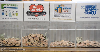 Wooden tokens represent five cents which can be placed toward the charity of your choice if you bring your own bag when shopping at New Earth Market in Chico, Calif. Wed. Aug. 17, 2016. (Bill Husa -- Enterprise-Record)