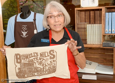 Gloria Veith, Gift Store Manager for the Bidwell Mansion Association shows items for sale relating to the Bidwell's that will be available for John Bidwell's 197th birthday celebration at the Bidwell Mansion Sunday Aug. 28th. Friday Aug. 19, 2016. (Bill Husa -- Enterprise-Record)