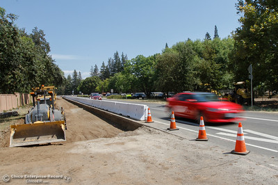 A thick wall barrier along Highway 32 West separates the road from dirt as road work continues August 16, 2016 in Chico, Calif. (Emily Bertolino -- Enterprise-Record)