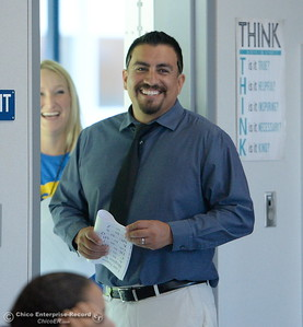Chico Junior High School Principal Pedro Caldera smiles beside Assistant Principal Jessica Kamph as they see how the sixth graders are mingling with the rest of the student body during their first day of school Thurs. Aug. 18, 2016. (Bill Husa -- Enterprise-Record)