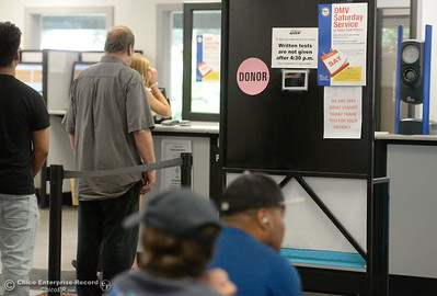 People wait in line at the DMV in Chico, Calif. Thursday July 26, 2018. (Bill Husa -- Enterprise-Record)