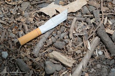 Discarded smokes are seen on the ground near the Sacramento River in Chico, Calif.  Monday June 25, 2018. (Bill Husa -- Enterprise-Record)