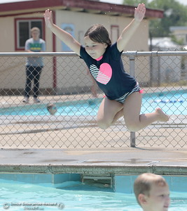 Kindergartener Londyn Leonard jumps in the pool at Nelson's Pool as FRRPD youth programs either stay indoors or limit activities to one hour outside during bad air quality days Orovile, Calif. Wednesday, Aug. 1, 2018.  (Bill Husa -- Enterprise-Record)