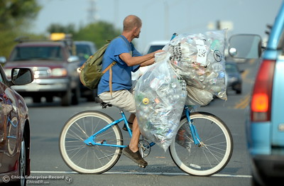 A recycler rides his bike across Skyway at the Notre Dame Blvd. intersection in Chico, Calif.  Friday Aug. 3, 2018.  (Bill Husa -- Enterprise-Record)