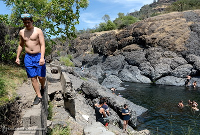 Alexander Zwinger of Chico walks along the old flume trail as people enjoy a swim in the cool waters of Big Chico Creek at Bear Hole in Upper Bidwell Park Thursday, July 12, 2018.  (Bill Husa -- Enterprise-Record)