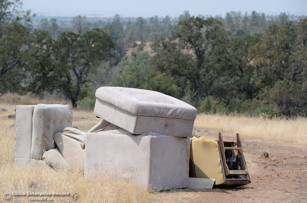 . Humboldt Road, which runs parallel to Hwy. 32 and an old rock wall is quickly beginning to look more like a public dump. Furniture, trash and glass bottles that appear to have been used as shooting targets are easy to find among the littered road just outside of Chico, Calif. Fri. Aug. 4, 2017. (Bill Husa -- Enterprise-Record)