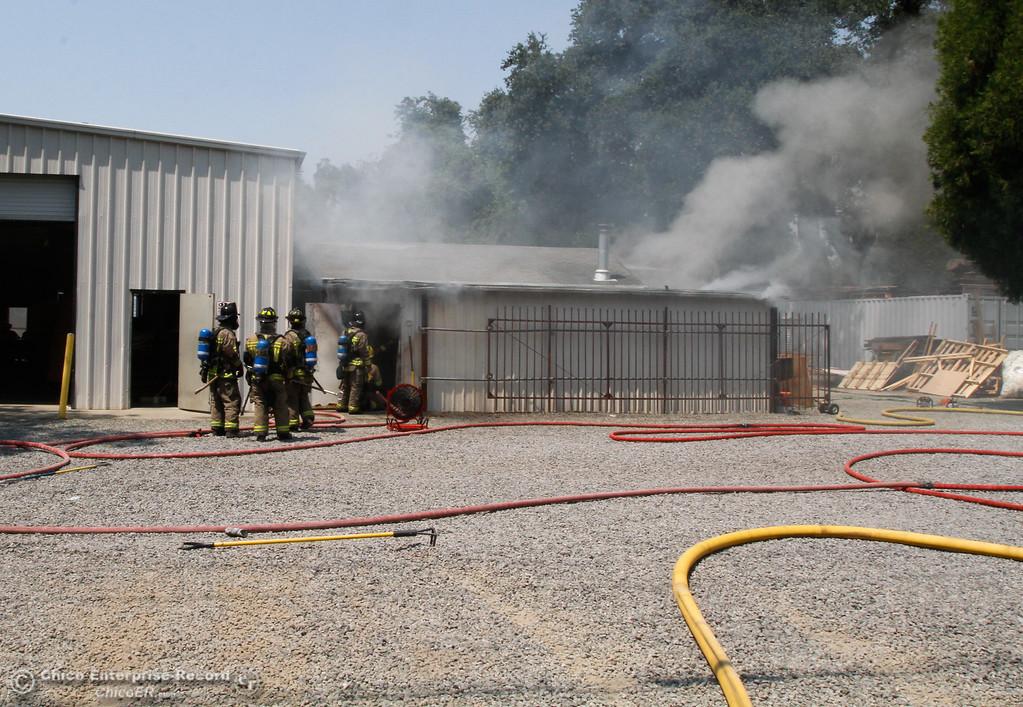 . Firefighters work to put out a fire in the wood shop of Square Deal Mattress Factory & Upholstery Tuesday August 1, 2017 along Humboldt Avenue in Chico, California. (Emily Bertolino -- Enterprise- Record)