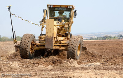 Heavy equipment works at a large grading project on the Canyon View property owned by CUSD Tuesday Aug. 1, 2017. The land was purchased as a location to build a third high school, but the district says that due to enrollment, it has no plans to build an additional high school and is instead working on the project in order to complete the final US Army Corps of Engineers permit requirement.  (Bill Husa -- Enterprise-Record)