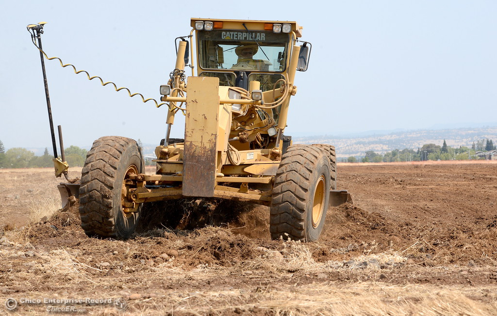 . Heavy equipment works at a large grading project on the Canyon View property owned by CUSD Tuesday Aug. 1, 2017. The land was purchased as a location to build a third high school, but the district says that due to enrollment, it has no plans to build an additional high school and is instead working on the project in order to complete the final US Army Corps of Engineers permit requirement.  (Bill Husa -- Enterprise-Record)