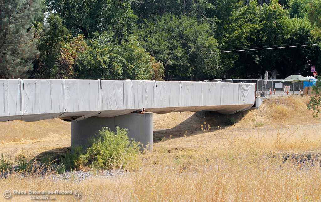 . Construction continues on the bike and pedestrian bridge over Lindo Channel between Ceres and Downing avenues in Chico as the wooden deck is being replaced with concrete Thursday August 3, 2017 in Chico, California. (Emily Bertolino -- Enterprise- Record)