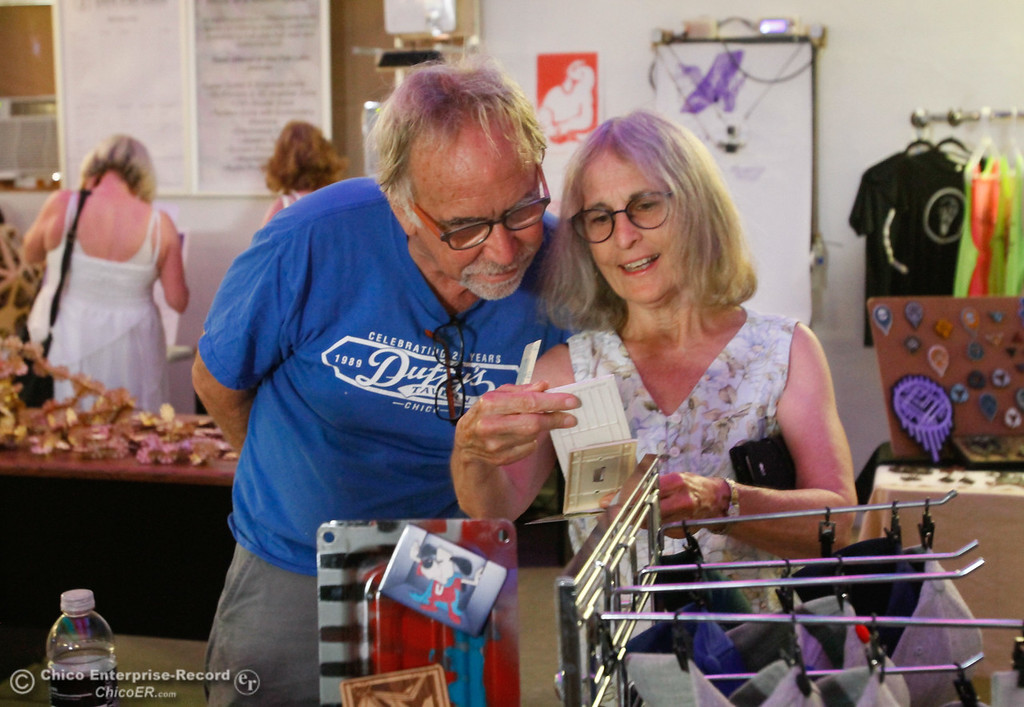 . Steve Metzger and Jan Hill look at laser cut tile pieces by Stephen Barry at the 4th annual Maker Show Case Saturday August 5, 2017 at Idea Fab Labs in Chico, California. (Emily Bertolino -- Enterprise- Record)