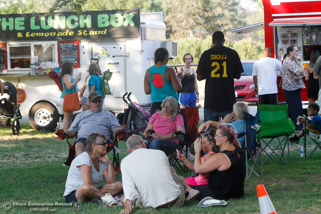. People gather for the monthly Fork in the Road food truck rally Wednesday August 2, 2017 in Chico, California. (Emily Bertolino -- Enterprise- Record)