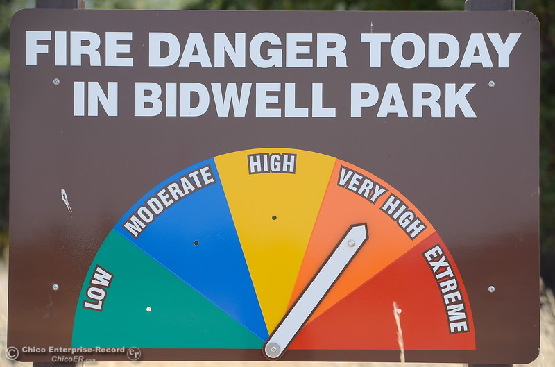 "A fire danger sign reminds visitors that no smoking is allowed along with no parking on road shoulders or grass areas as the fire danger creeps up to ""very high""  Monday July 31, 2017.  (Bill Husa -- Enterprise-Record)"