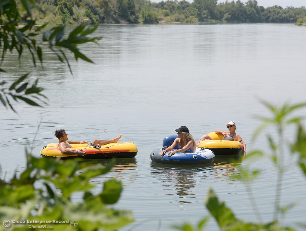 . Members of the Skene Family, Kevin, Haley and Denise left to right keep cool as they enjoy a float on the Sacramento River near the Pine Creek inlet Monday July 31, 2017.  (Bill Husa -- Enterprise-Record)