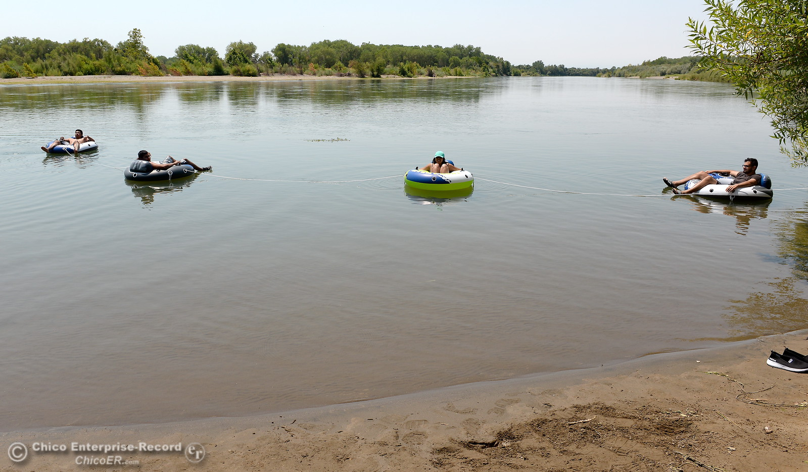 A group from Chico and Orland enjoy a float on the Sacramento River near the Pine Creek inlet Monday July 31, 2017. Left to right are Mark Bungay, Edwardo Rios, Adriana Pano and Gilberto Rios-Torres.  (Bill Husa -- Enterprise-Record)