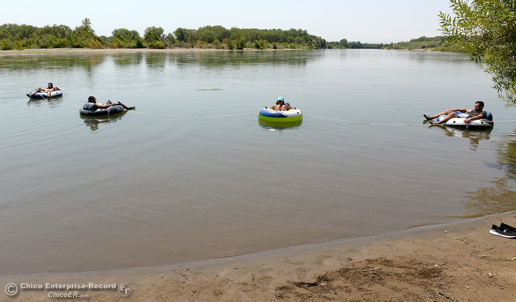 . A group from Chico and Orland enjoy a float on the Sacramento River near the Pine Creek inlet Monday July 31, 2017. Left to right are Mark Bungay, Edwardo Rios, Adriana Pano and Gilberto Rios-Torres.  (Bill Husa -- Enterprise-Record)