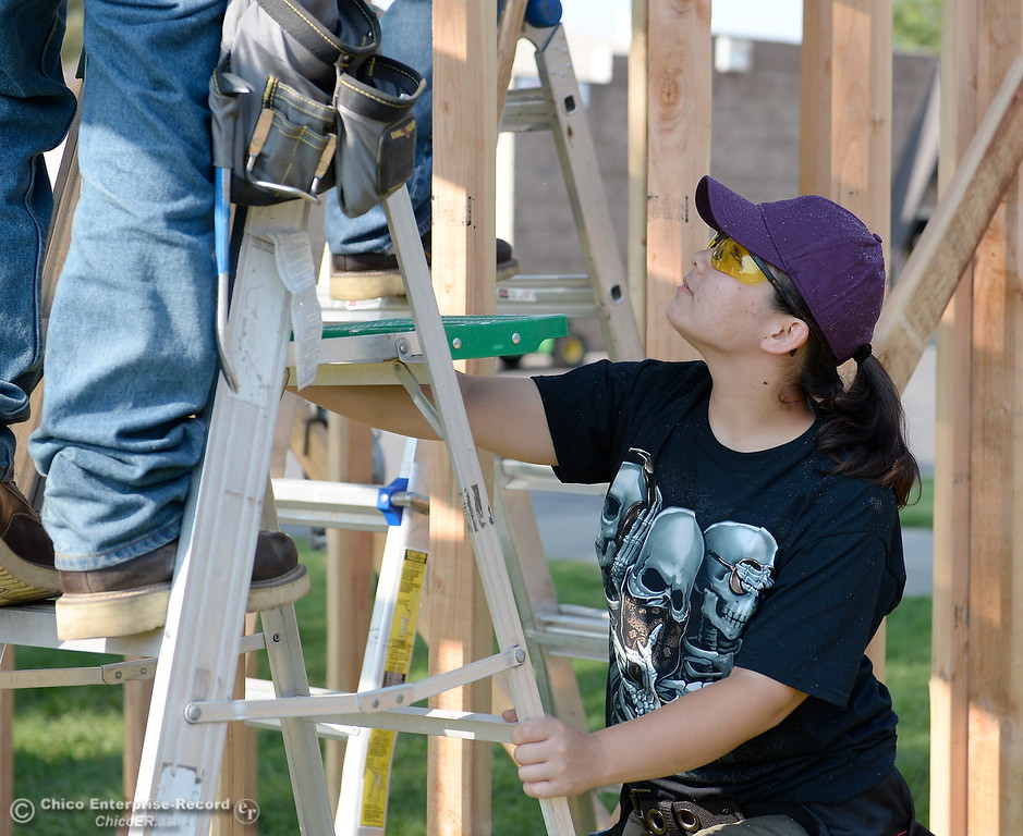 . Ashley Green holds a ladder while building a shed during the BCOE Construction Bootcamp with Instructor Jack Rodgers at the Silver Dollar Fairgrounds in Chico, Calif. Thurs. Aug. 3 2017. (Bill Husa -- Enterprise-Record)